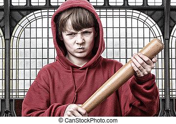 Aggression - Young aggresive teenage boy with a baseball bat