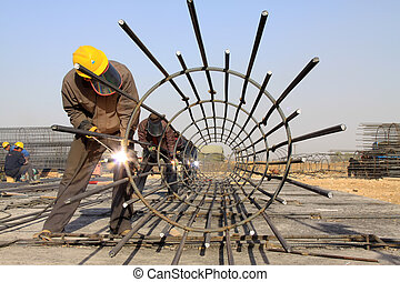 reinforced component at the construction site and workers,...