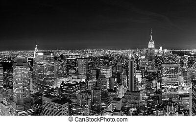 New York City Manhattan skyline at night panorama black and...