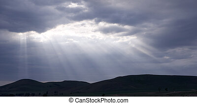Clouds with a sunbeam shining through.