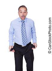 Businessman Showing Empty Pockets