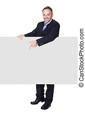 Happy Businessman Holding Blank Billboard On White...