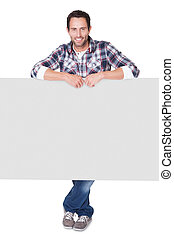 Happy middle age man presenting empty banner. Isolated on...