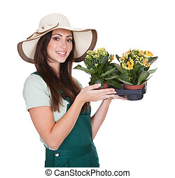Beautiful Happy Woman Holding Flower Plant. Isolated On...