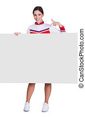 Cheerleader Pointing On Blank Placard Isolated On White