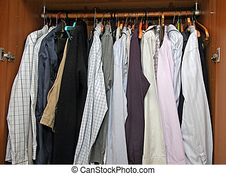 open closet with many elegant shirts for important meetings...