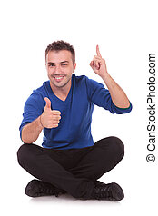 man sitting making ok and pointing up - Portrait of a casual...