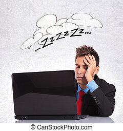 business man sleeping on his office desk