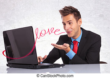 chat, networking, love - young man in suit sending his love...