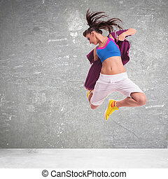 woman dancer screaming and making a difficult jump