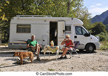Traveling by mobile home - Elderly couple is traveling by...