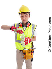 Young builder drinking a bottle of water