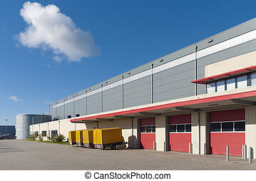 warehouse exterior - large warehouse with red loading docks...