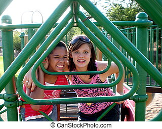 Friends on playground - A picture of two young girls on the...
