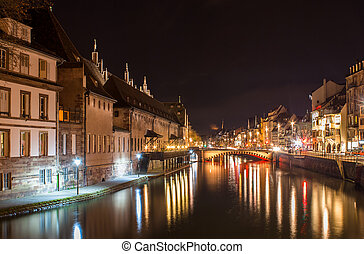 Ill river in Strasbourg - Alsace, France. Old Customs House...
