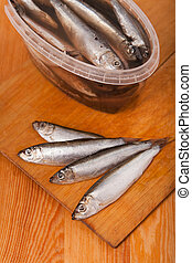 salted anchovies in box on wooden