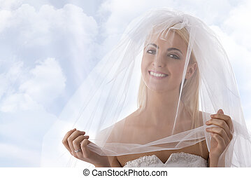bride with veil on the face smiles