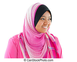 Portrait of Southeast Asian Muslim girl smiling, isolated on...