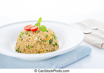 Chinese egg fried rice with spoon and fork on dining table