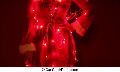 Beautiful Santa girl with lights