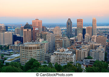 Montreal city skyline at sunset viewed from mont royal with