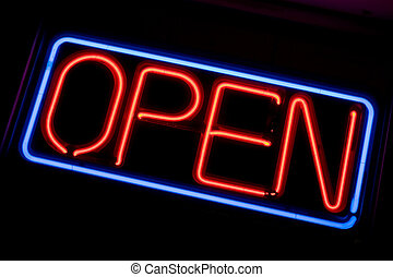 Neon OPEN Sign - A neon OPEN sign glowing red in the window...