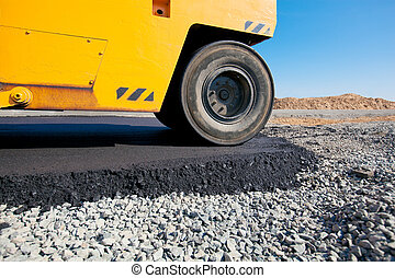 Road roller leveling fresh asphalt - Road roller laying...