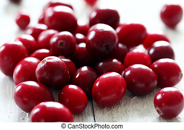 Fresh cranberries on a white table - Fresh cranberries on a...