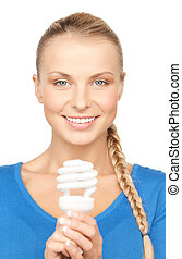 woman with energy saving bulb - picture of attractive woman...