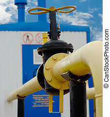 Yellow Pipe - Gas pipe with valve near transportation...