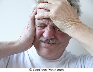 senior man with terrible headache - older man suffering from...