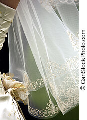 Wedding veil and part of a wedding dress
