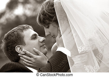 Newly married pair - The groom kisses the bride