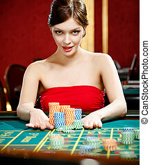 Woman placing a bet at the casino