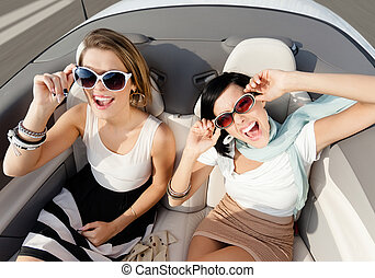 Top view of women in the cabriolet - Top view of happy women...