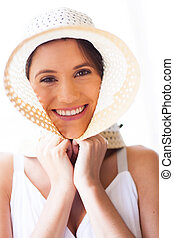 cute young woman with summer hat
