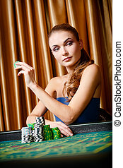 Female gambler at the roulette table