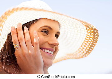 happy young woman with summer hat daydreaming