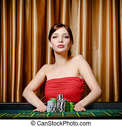 Woman stakes pile of chips playing roulette
