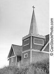 Hilltop Worship - An old church sitting on a hilltop in...