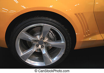 Drive - Rear wheel detail on a modern muscle car