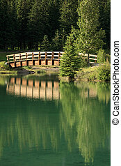 Bridge Reflected - An arched bridge reflected in calm water