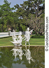 White fairy sculptures of winged creatures - A magnificent...