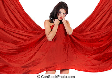 beautiful girl covering herself with a red cloth - View of a...