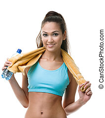Sportive woman with bottle of water and yellow towel,...