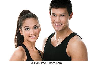 Portrait of two sportive people in black sportswear,...