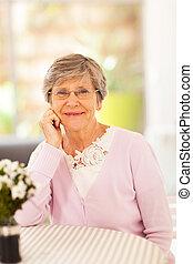 elegant senior woman at home