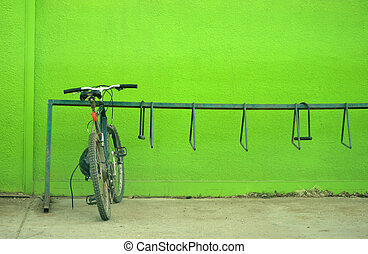 Go Green - A mountain bike parked against a bright green...