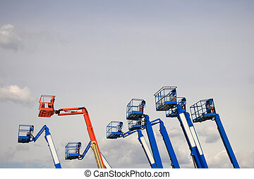 Reach - A group of construction lifts extended into the sky