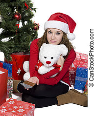portrait of a young woman with teddy bear and credit card
